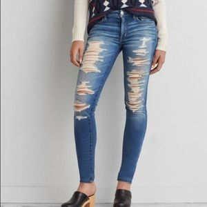 AEO Distressed Mid-Rise Extreme Flex Jeans